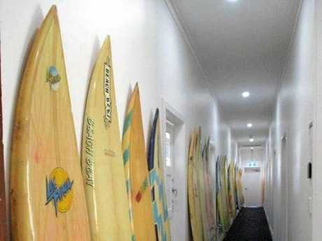 Vintage surfboards mounted along the corridor of 'The Boarding Office' in the former Club Hotel building, corner of Currie and Mill Streets, Nambour, September 2017.