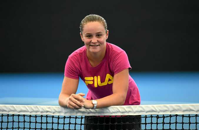 Ashleigh Barty poses for photos at Pat Rafter arena in Brisbane