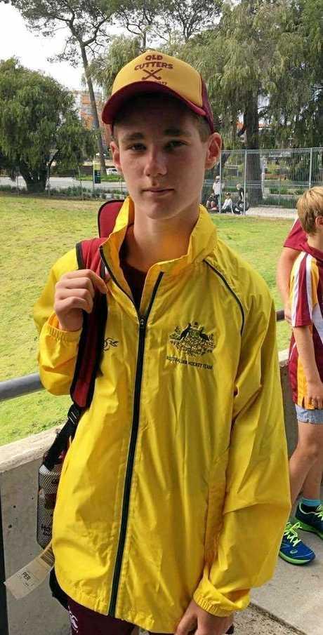 Josh Hagenbach with the Australian Kookaburras blazer he won a coaches' award winner with the Queensland Cutters.