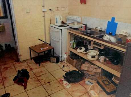 Michael Phillip Martin trial, crime scene photos. View showing the kitchen.
