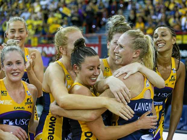 Lightning players celebrate their win in the Super Netball grand final over the Giants in June.