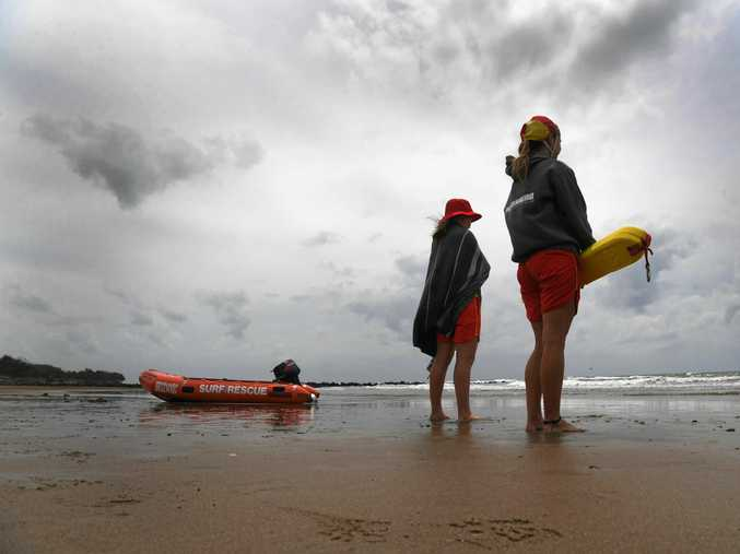 THE RAINS ARE 'ERE: Lifeguards Erin Gardner and Cleo Kauffman keep an eye on bathers at Nielson Park Beach.