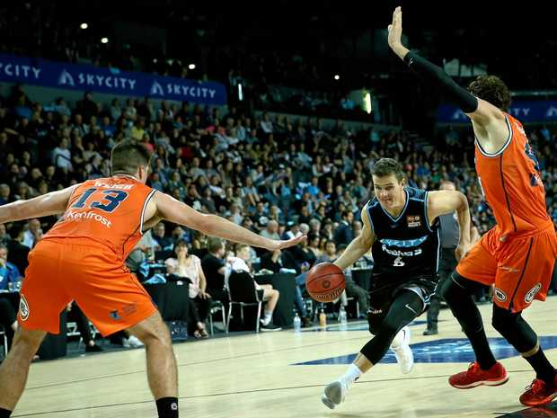 Breakers guard Kirk Penney drives towards the hoop against the Taipans.