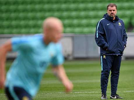 Socceroos coach Ange Postecoglou watches on at training.