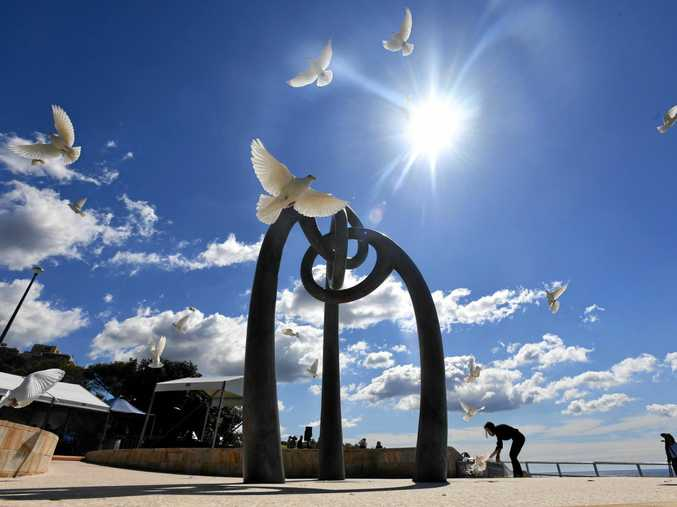 White doves are released to signify the 88 Australian lives lost in the 2002 Bali bombings, at the Bali Memorial at Dolphins Point, Coogee in Sydney.