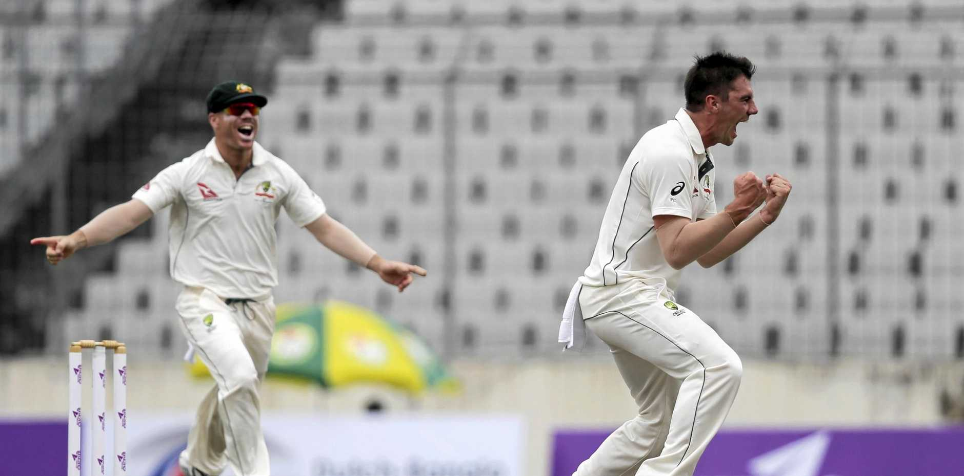 Pat Cummins, right, celebrates after claiming a wicket in a Test against Bangladesh.