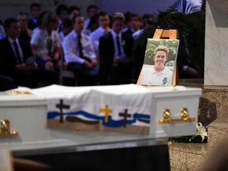 A portrait of 18 year-old one-punch victim Cole Miller is placed near the coffin during his funeral service last year. Cole died in hospital on January 4 from massive brain trauma a day after allegedly being hit in Brisbane's Fortitude Valley. (AAP Image/Dan Peled)