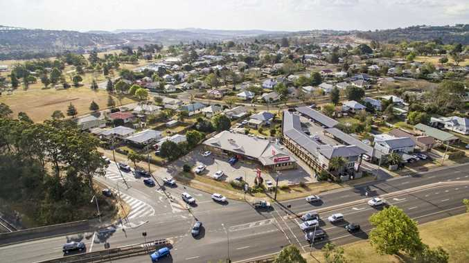 FOR SALE: The Harlaxton shopping centre, featuring Red Rooster and Foodworks, will go under the hammer at the end of October.