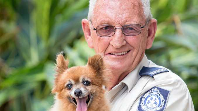 DOUBLE CELEBRATION: Ipswich RSPCA inspector Mr Stageman, 64, is celebrating two milestones, starting work with the RSPCA 17 years ago and his little pooch's 18th birthday.