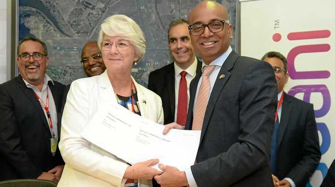 L-R Rockhampton Mayor Margaret Stelow with Adani Australia CEO Jeyakumar Janakaraj sign the MOU regarding the Charmichael Mine FIFO hub.