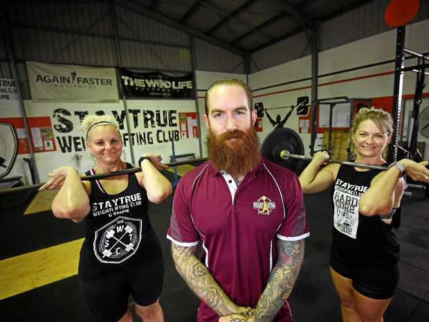 PUMPED UP: Weightlifting team Tilia Tonkin, coach Cameron Arthur and Sandie Branson, from Gympie.