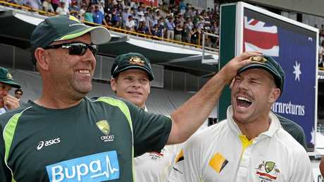 Coach Darren Lehmann (left) celebrates the 2013-14 Ashes win with Dave Warner, with Steve Smith in the background.