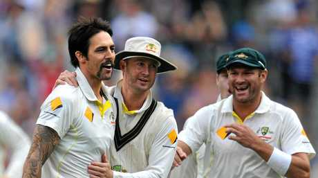 Mitchell Johnson, Michael Clarke and Ryan Harris celebrate an English wicket during the 2013 Boxing Day Test