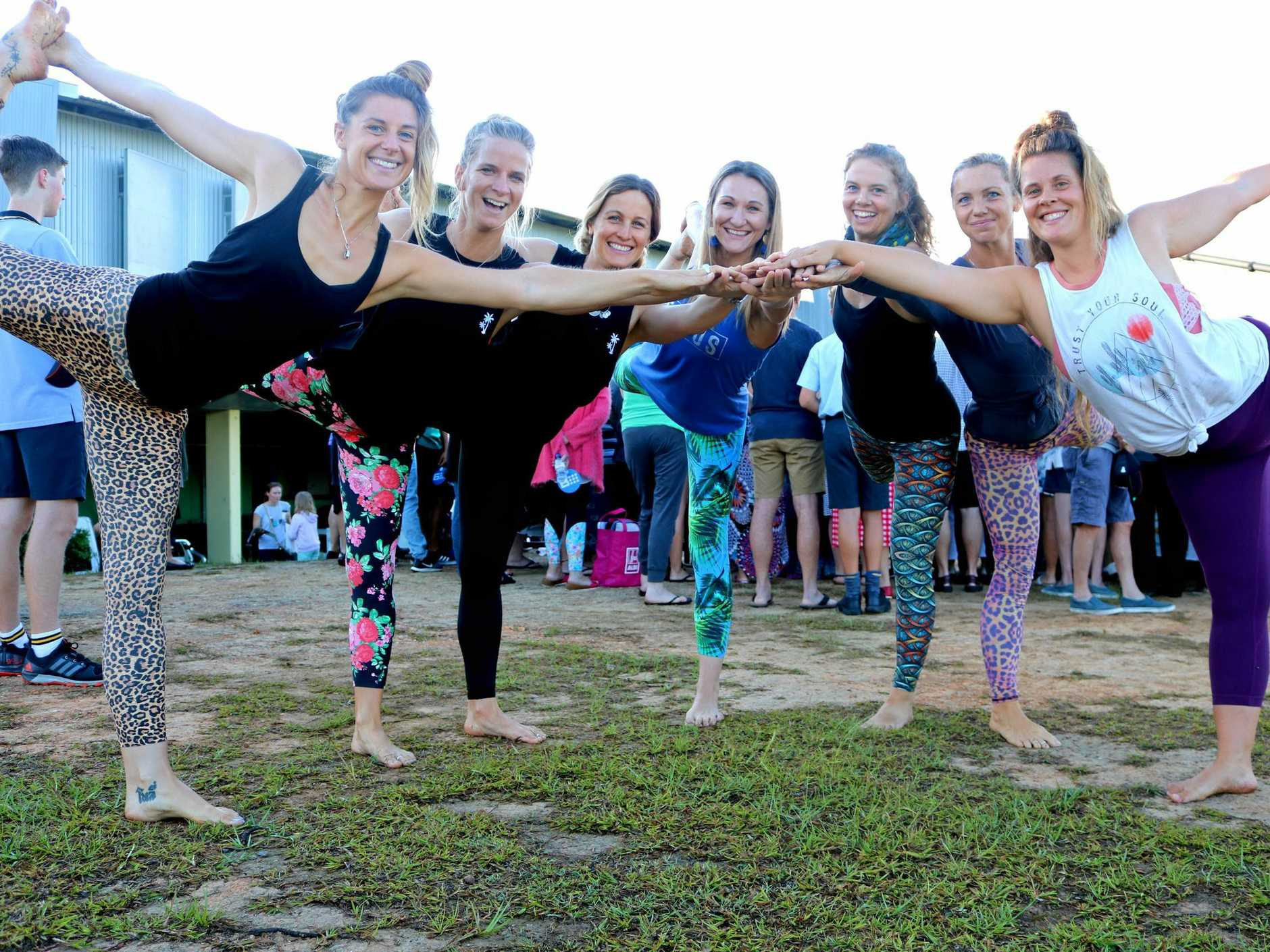 The girls from Heatwave Hot Yoga strike a pose after taking Richard Wilkins through a live  yoga routine during the TODAY Show live broadcast from Tweed Regional Gallery, Murwillumbah on Friday, October 13, 2017.