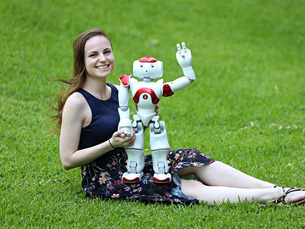 Nicole Robinson is a psychology PhD student at QUT who is working with robots. She is with