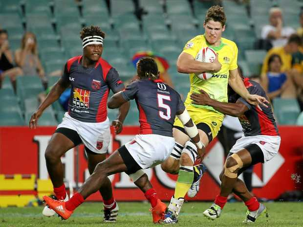 FORCEFUL: Australia's Charlie Taylor powers through the Papua New Guinean defence at the Sydney Rugby Sevens.