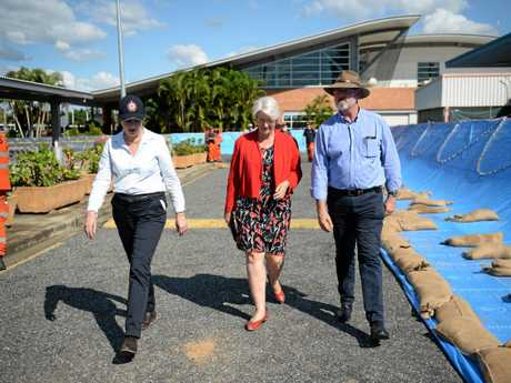 Queensland Premier Annastacia Palaszczuk with Rockhampton mayor Margaret Strelow and State Member for Rockhampton Bill Byrne at the Rockhampton Airport, where 20 SES volunteers built a barrier around the control tower in preparation for a major flood this week.