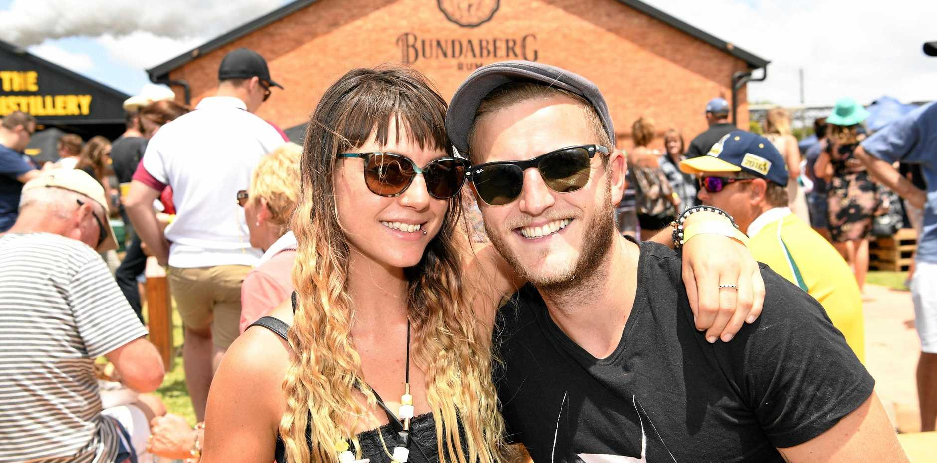 OVERSEAS VISITORS: Tamsin Pape and Richard Manning from the UK enjoy the Bundaberg Rum Festival.