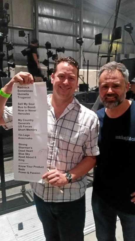 OILS GIG: Morning Bulletin reporter Leighton Smith (left) holding the Midnight Oil set list with Brisbane's Mick Smith.