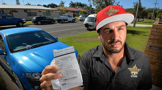 Robin Glesk was fuming after copping $180 worth of fines in 15 minutes for parking in his driveway and on the verge.