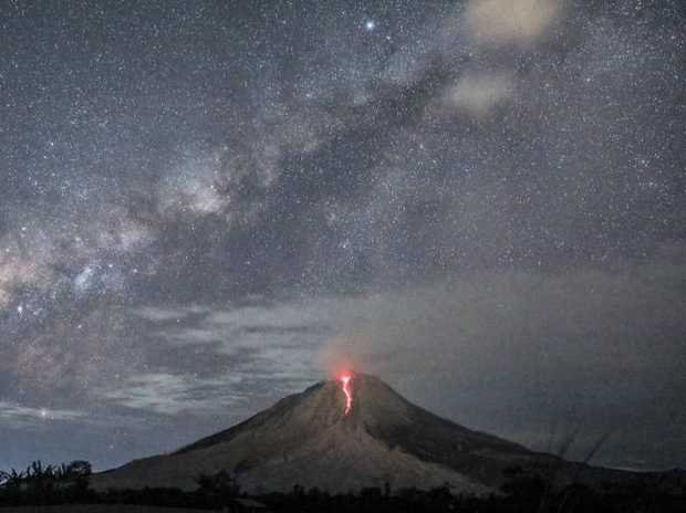 Molten lava spilling from Mount Sinabung as seen from Sukandebi village in Karo, North Sumatra, in August 2017. Picture: Dedi SinuhajiSource:AAP