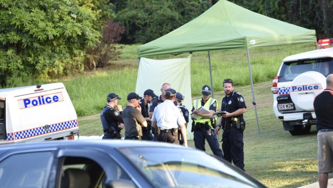 Police at the scene where the bodies were found.