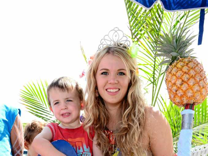 RIGHT: Pinefest princess Alana Murray with her little brother Thomas in the 2014 Pinefest Ray White Yeppoon Grand Street Parade.