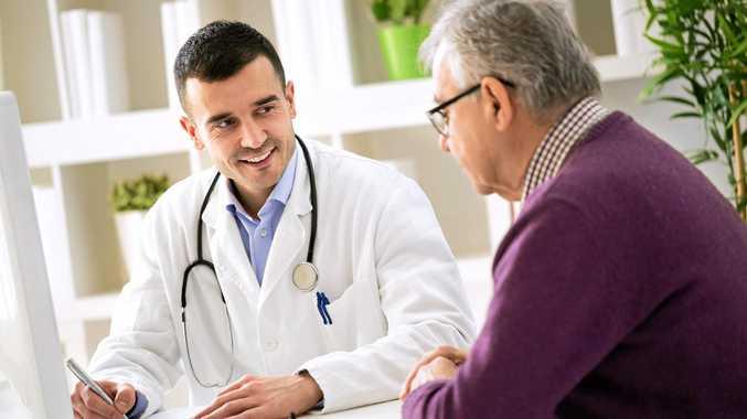 Doctor explaining prescription to patient.