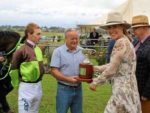 Face of the Cup Jess Somes (second from right) presenting jockey Benjamin Looker and trainer John Shelton with the Warwick Credit Union Warwick Cup for their win with Belflyer, and race sponsor Warwick Credit Union CEO Lewis von Stieglitz.