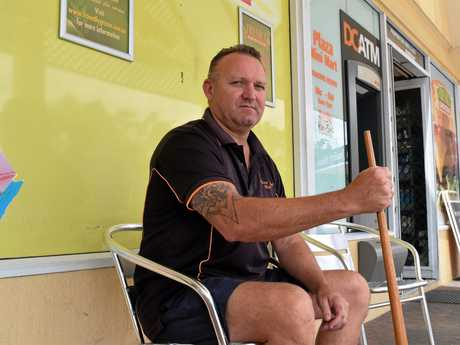 TAKING A STAND: Kawungan Plaza Mini Mart owner Rob Harrison used his trusty pool cue to chase out a knife-wielding robber on Saturday afternoon.