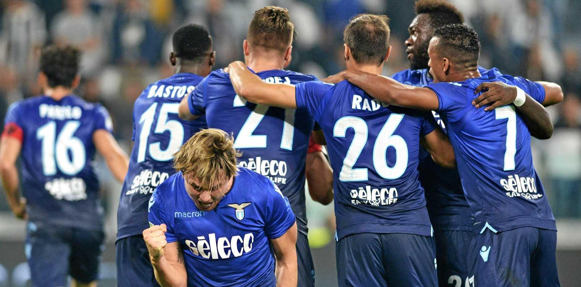 Lazio players celebrate the 2-1 win over Juventus.