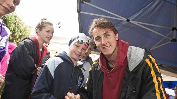 IDOL: Dual Olympian Cameron McEvoy (right) with Toowoomba Grammar Swimming Club member Juert Eerkens at Toowoomba Flyers Swimming Club's Spring Meet at Milne Bay Aquatic Centre yesterday.