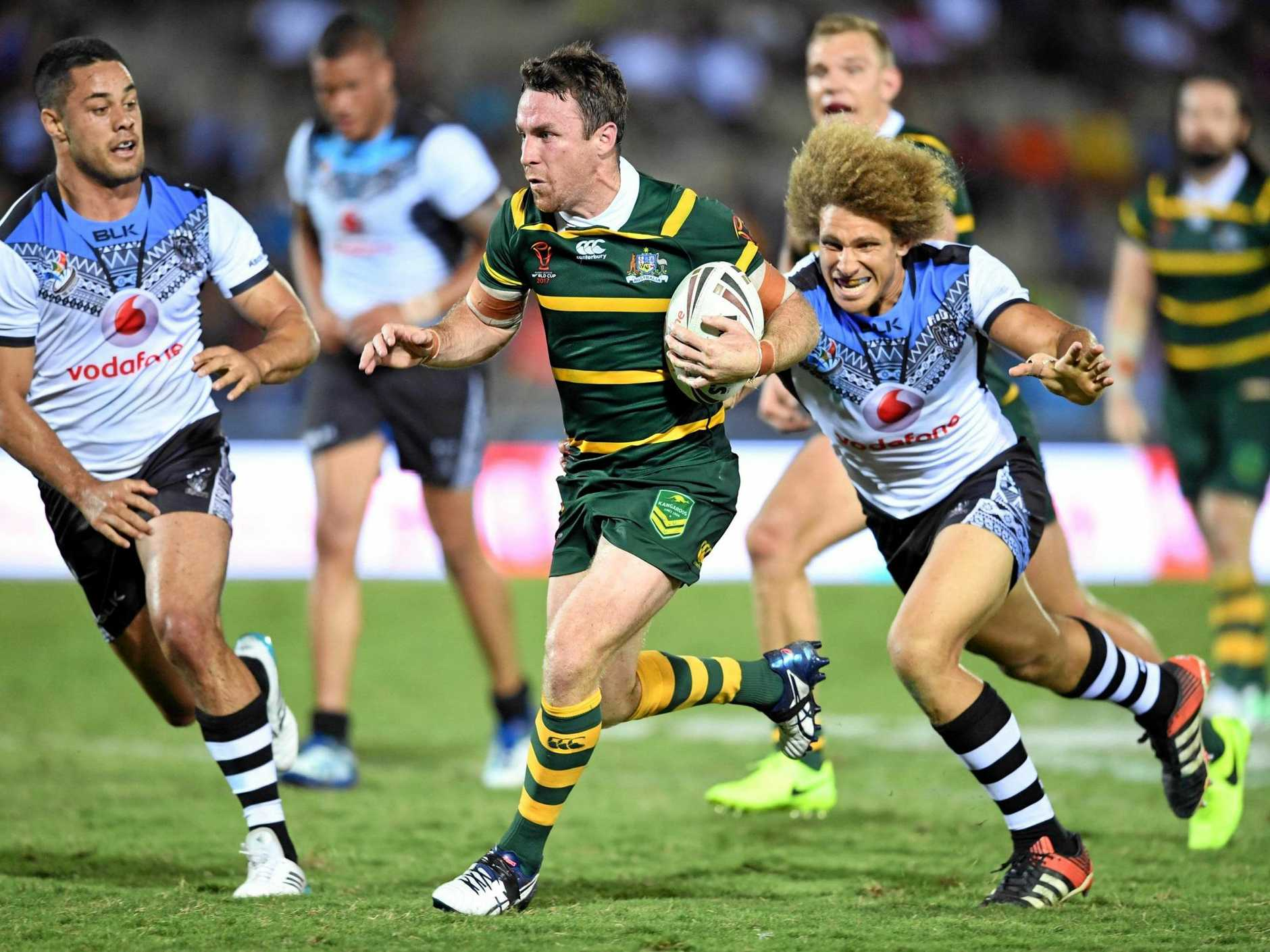 LAYING DOWN GAUNTLET: James Maloney in action against Fiji.