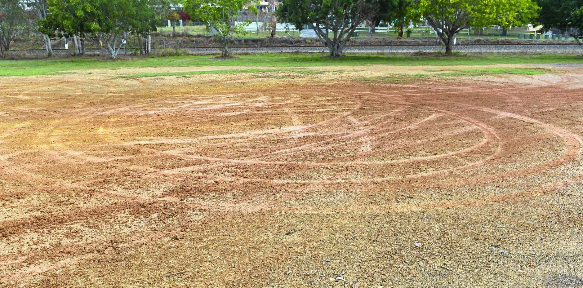 Photos of a local soccer field, after drivers were allegedly seen doing burnouts.
