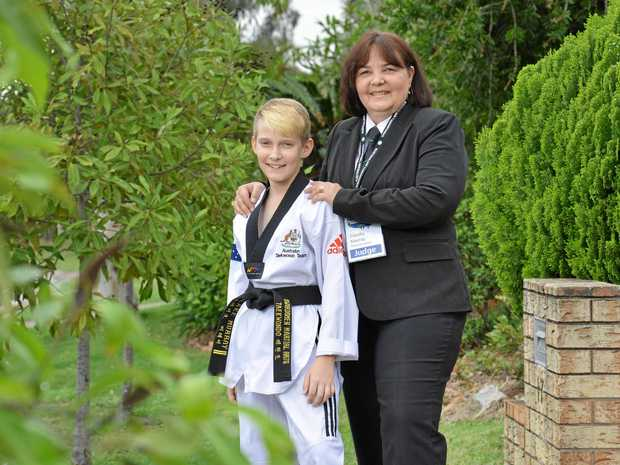 GIVING BACK: Claudia Murray of Flinders View will officiate at the Commonwealth Games next year. Pictured with her son Blake, 12.