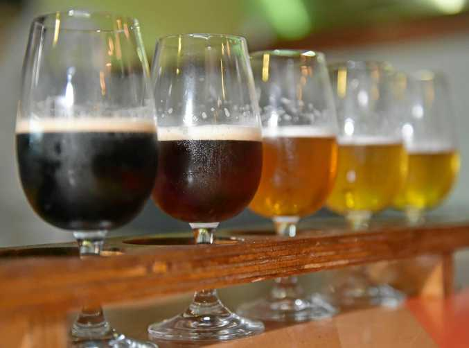 A selection of beers on a tasting paddle.