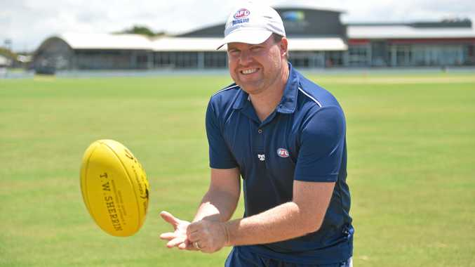TRY IT: AFL Queensland competition and club development officer Paul Scallie is urging people to pick up a Sherrin.