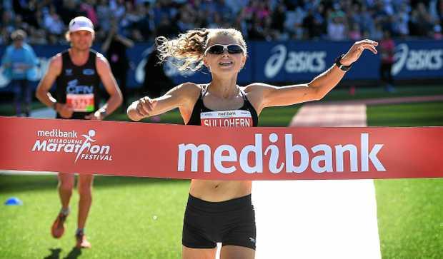 WINNER: Celia Sullohern wins the women's Melbourne Marathon at the MCG in Melbourne.