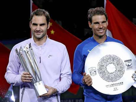 Roger Federer  and Rafael Nadal pose with their trophies after the award ceremony for the Shanghai Masters