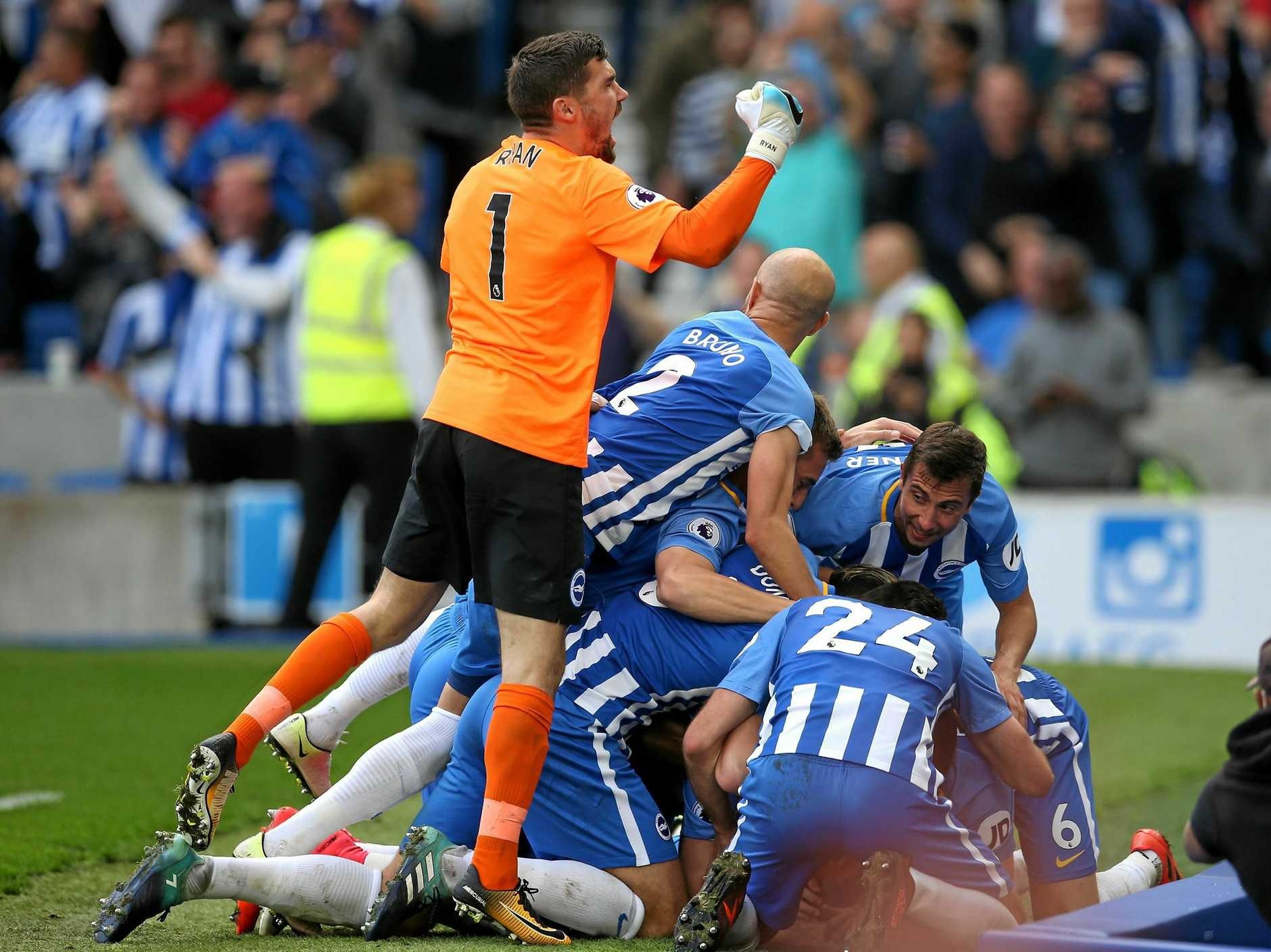 Mathew Ryan of Brighton and Hove Albion and teammates celebrate Anthony Knockaert's goal in the 1-1 draw with Everton.