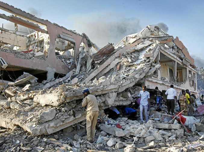 Somalis search for survivors after a huge explosion in the capital, Mogadishu.