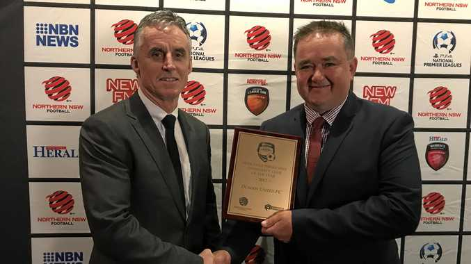 BIG AWARD: Football Far North Coast chairman Bill Coulter with Scott McNeill who accepted the Northern NSW Football Club of the Year Award for Dunoon United.