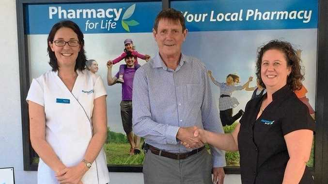 Pharmacy for Life Nambour Heights owners Rachel Campbell and Julianna Neill present Max Hutton, from Alzheimer's Australia Queensland, with a donation of $1000.
