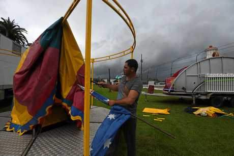 Pinks Kiddie Land staff Graham Mexon and Adam Hampton get the rides ready in time for the Lismore Show despite heavy showers drenching the Far North Coast.