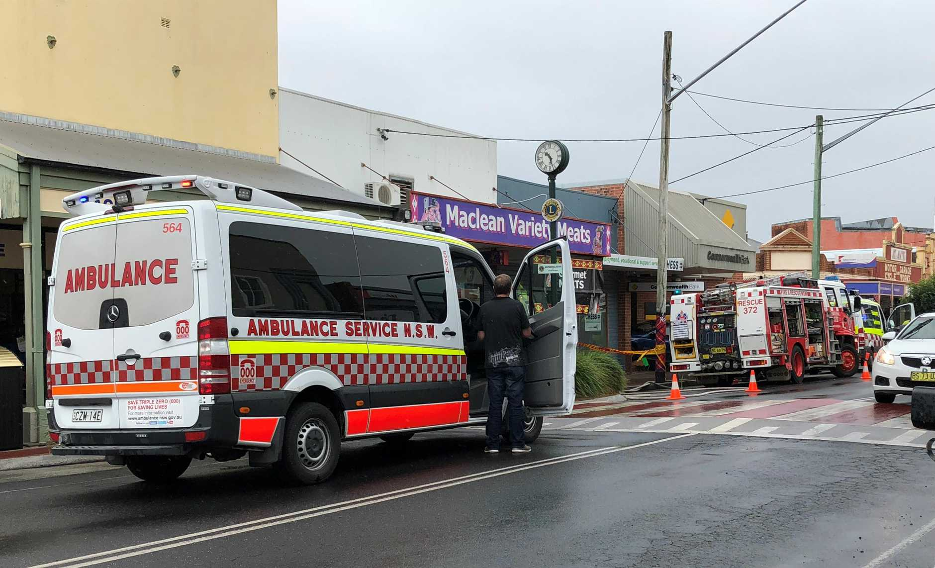 Emergency services responding to a crash where a car left the road and slammed into the Commonwealth Bank in Maclean.