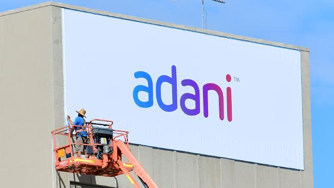 Adani sign being put up on Telstra building in Sou