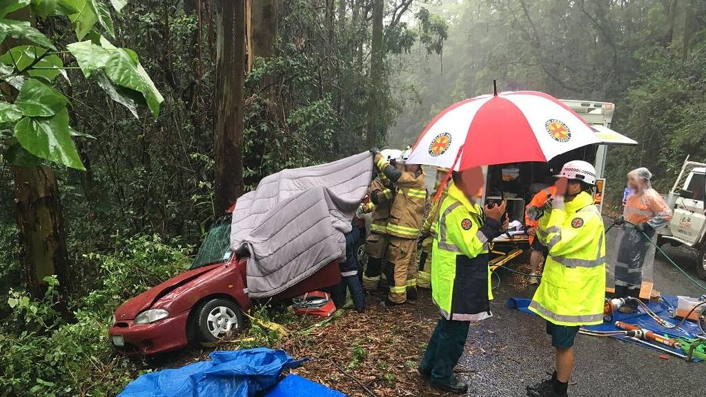 A woman was trapped in a vehicle for more than an hour following a crash near Maleny.