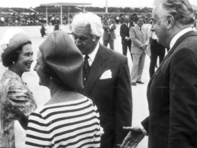 Whitlam, right, greets the Queen as Governor-General Sir John Kerr looks on.
