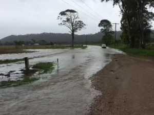 Motorist risks floodwaters