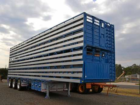A Byrne Trailers' stainless steel '4x2' tri axle livestock trailer.